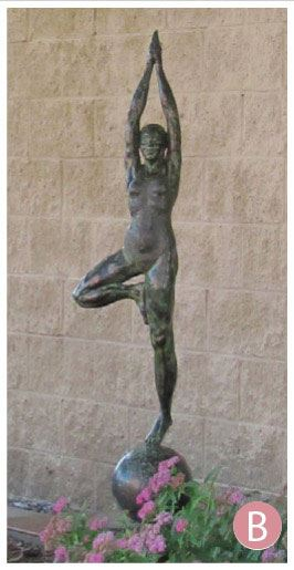 sculpture of person in yoga pose